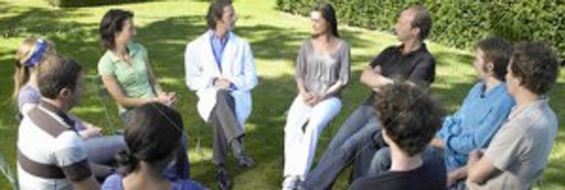 Group of people in a therapy session outside